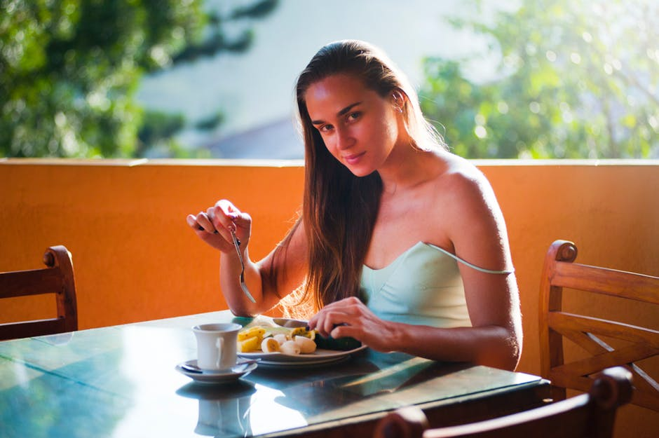 woman eating alone