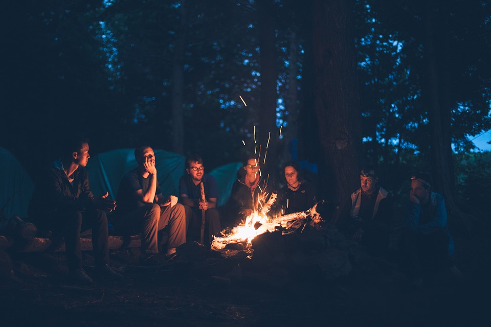 people round camp fire